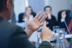 Man speaking in business meeting